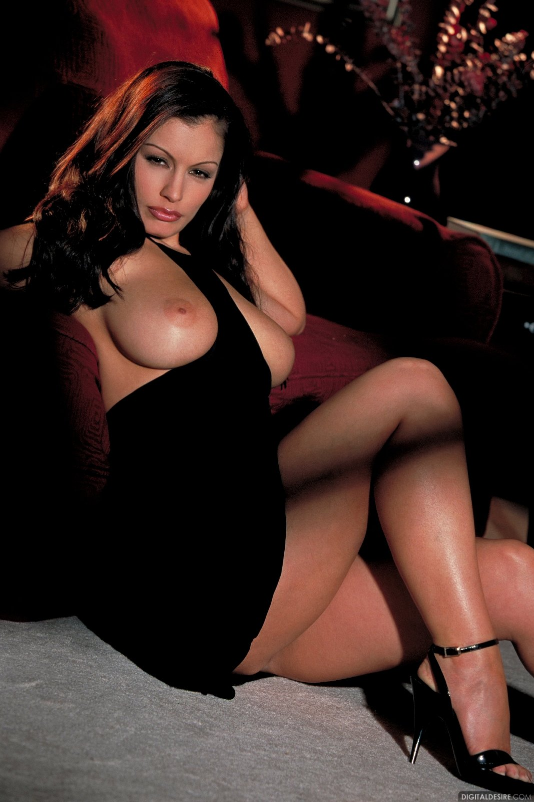 aria giovanni busts out her wonders from her black dress