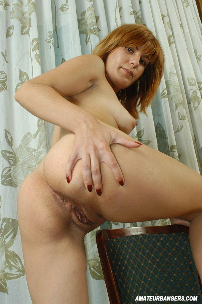 Naked redhead playing with her pussy
