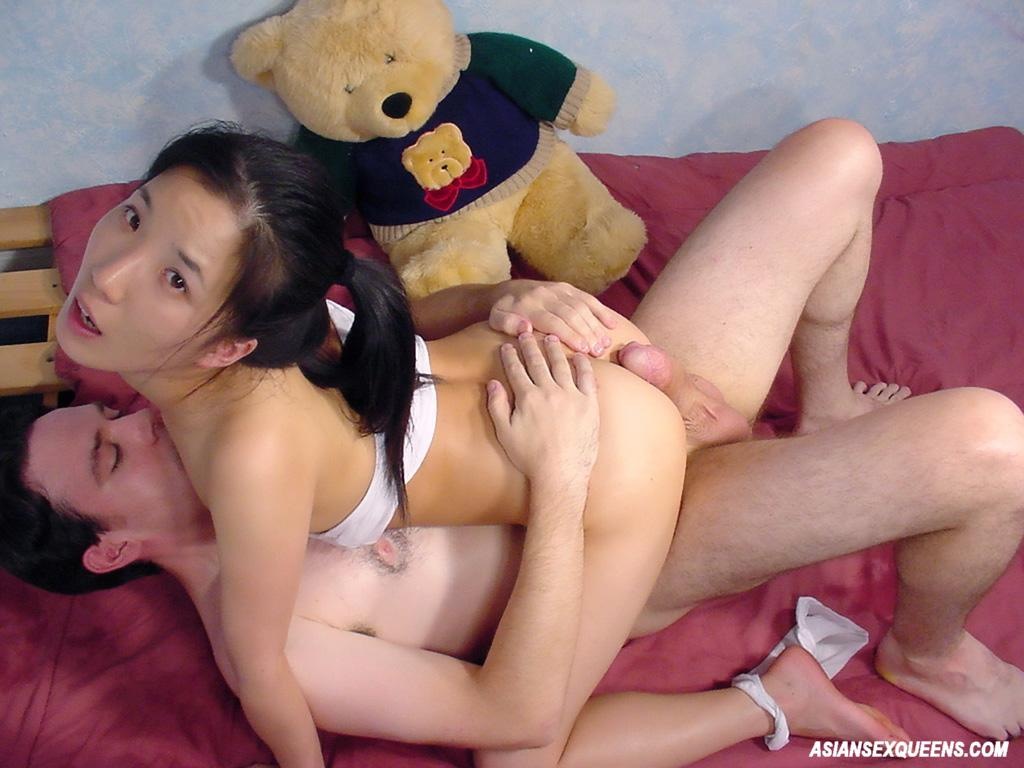asian teases stretched out pussy