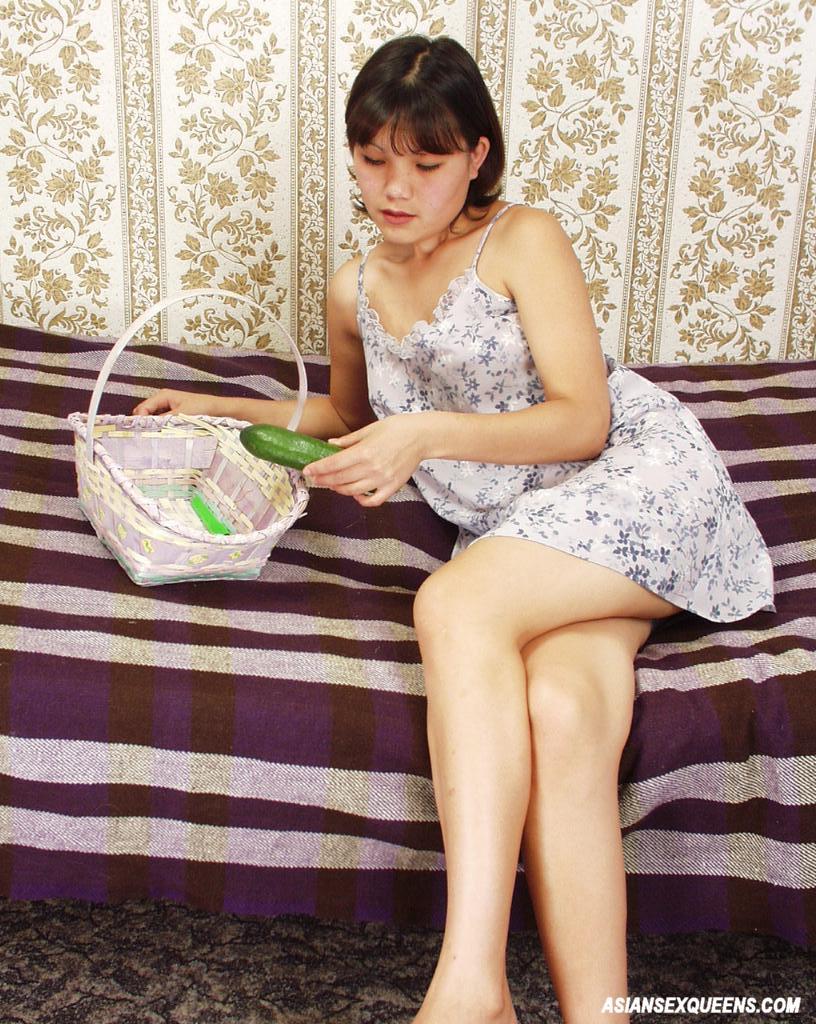 Sexy Asian Slut Masturbating with a Big Cucumber 2468
