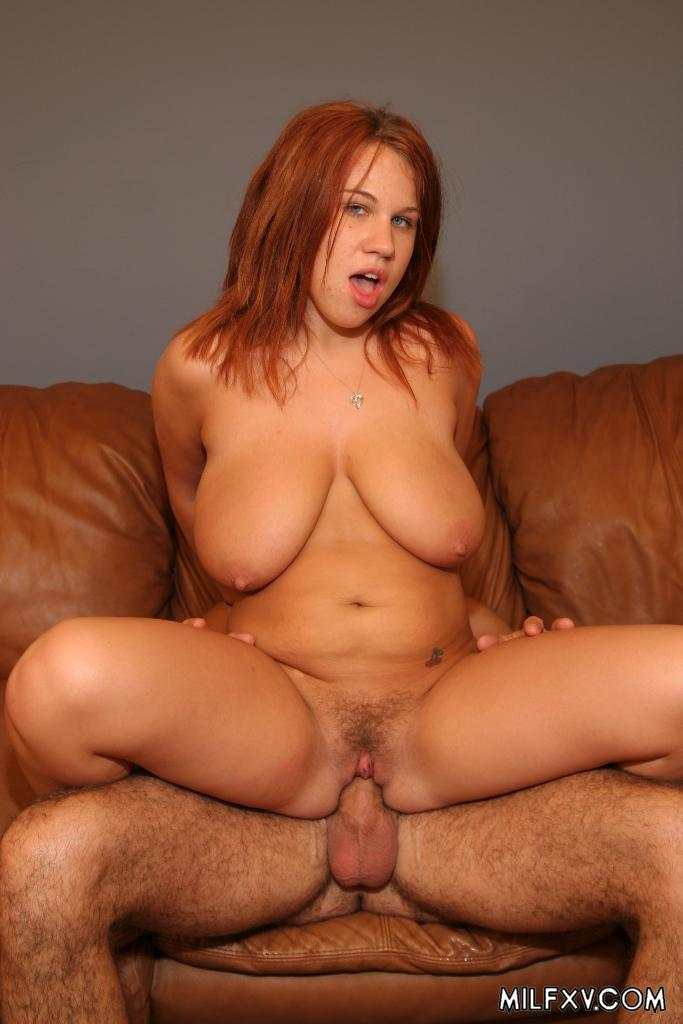 image Red headed milf fucked on the couch