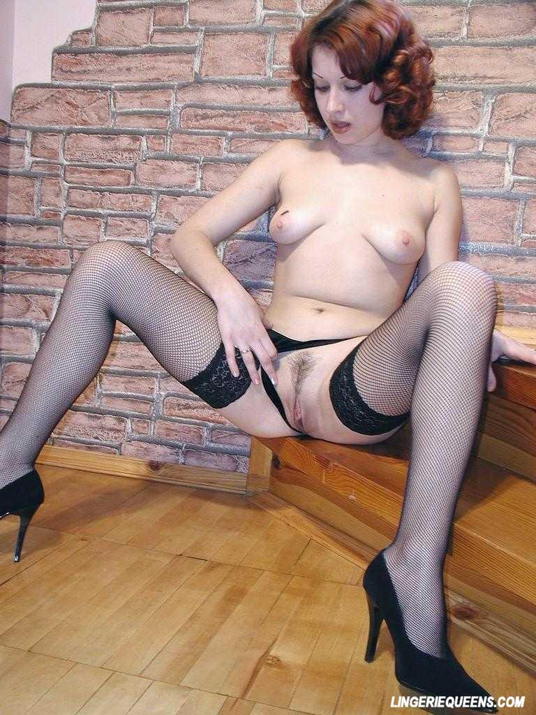 Busty redhead pleasuring herself