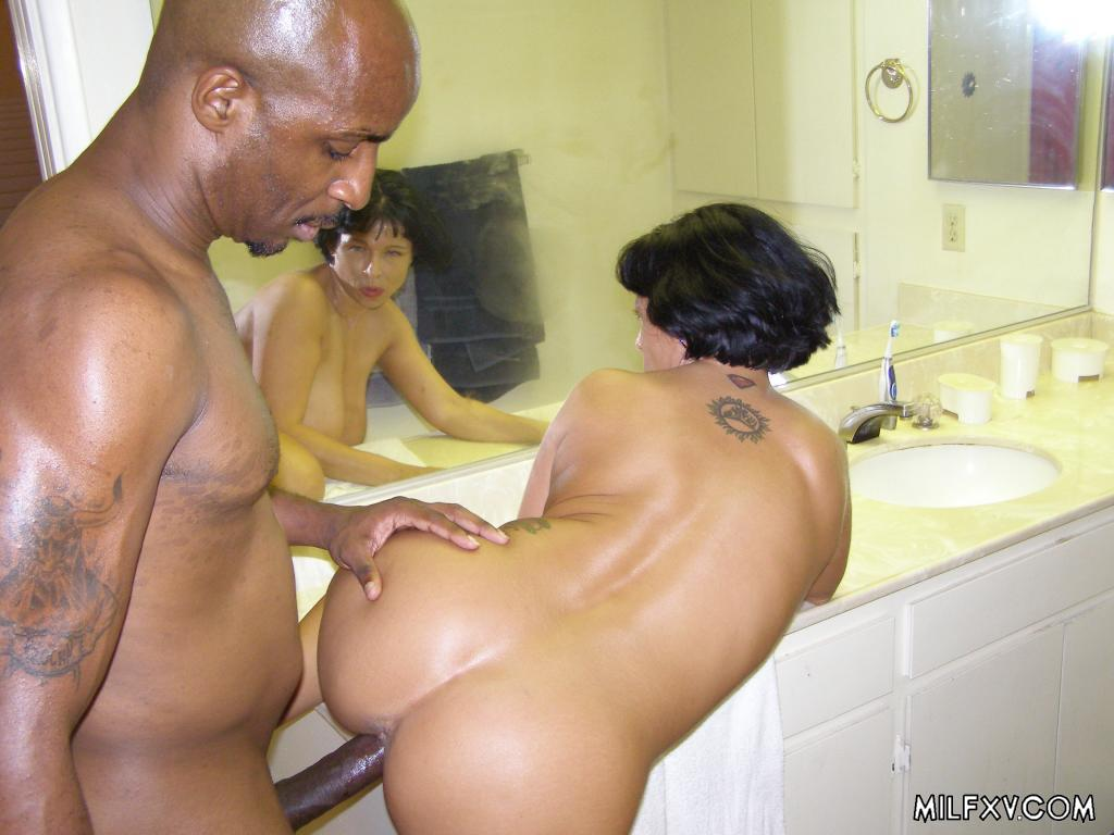 Brunette milf shared by three black studs