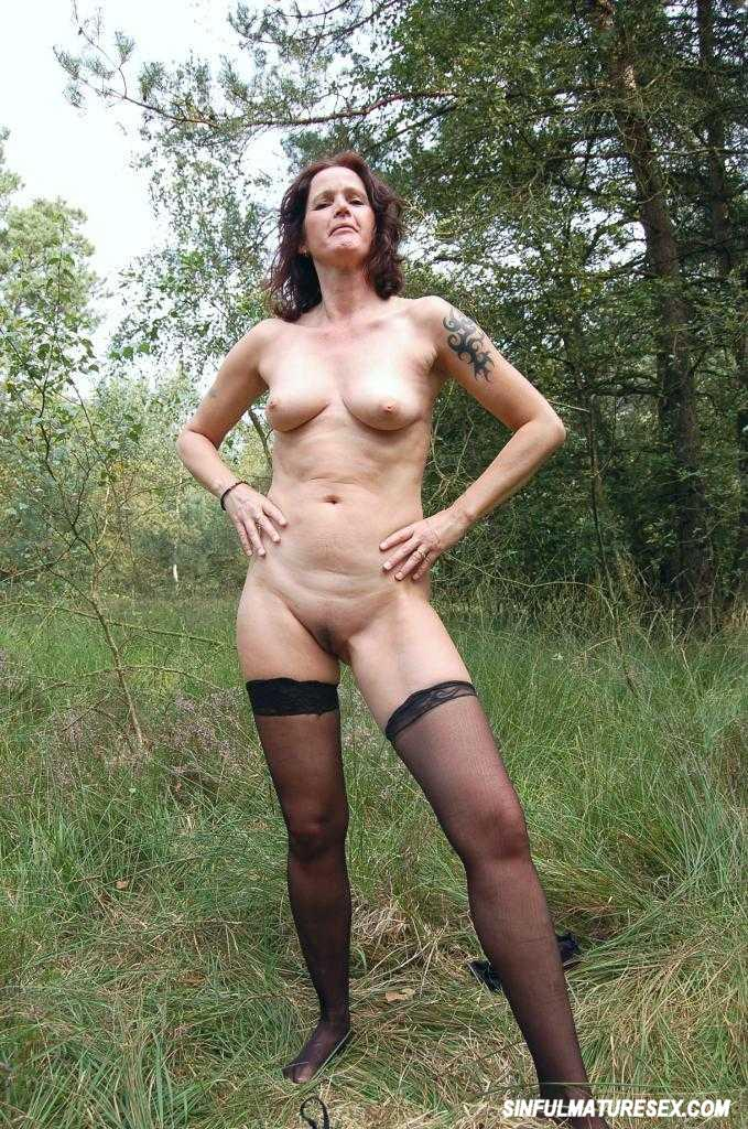 Busty granny having fun in the forest 1