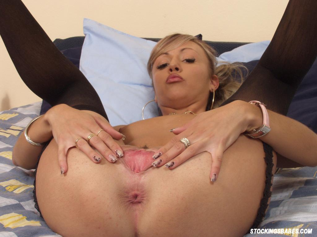 image Sexy blonde milf fingers her cunt while home alone