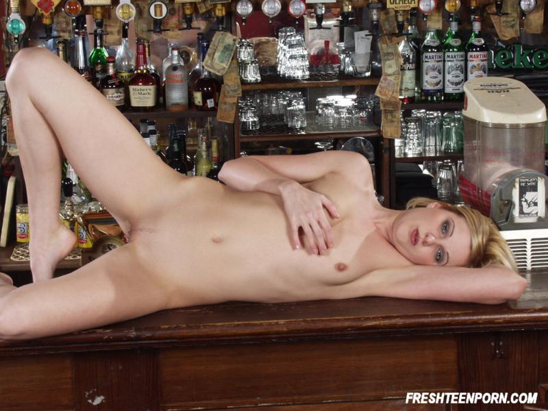 Blonde shows pussy at bar