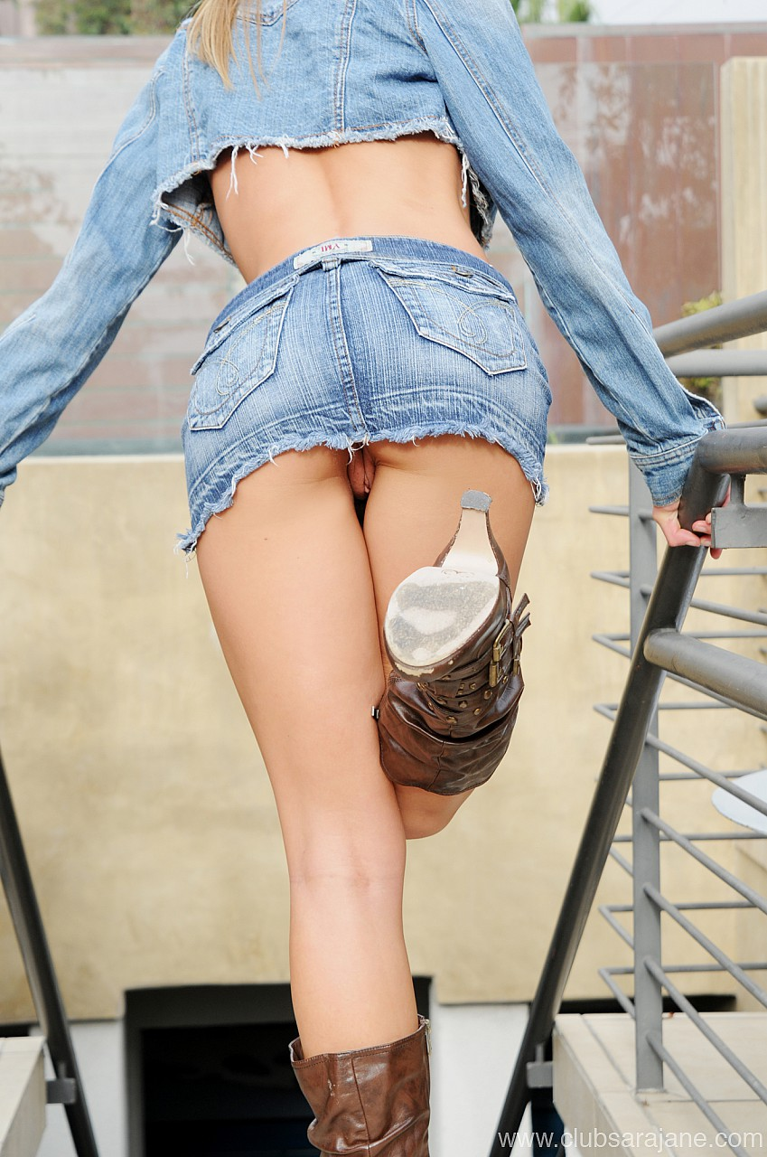 Sexy Lady In Short Skirt Preparing To Play Tennis Swinging Racket Closeup Stock Photo
