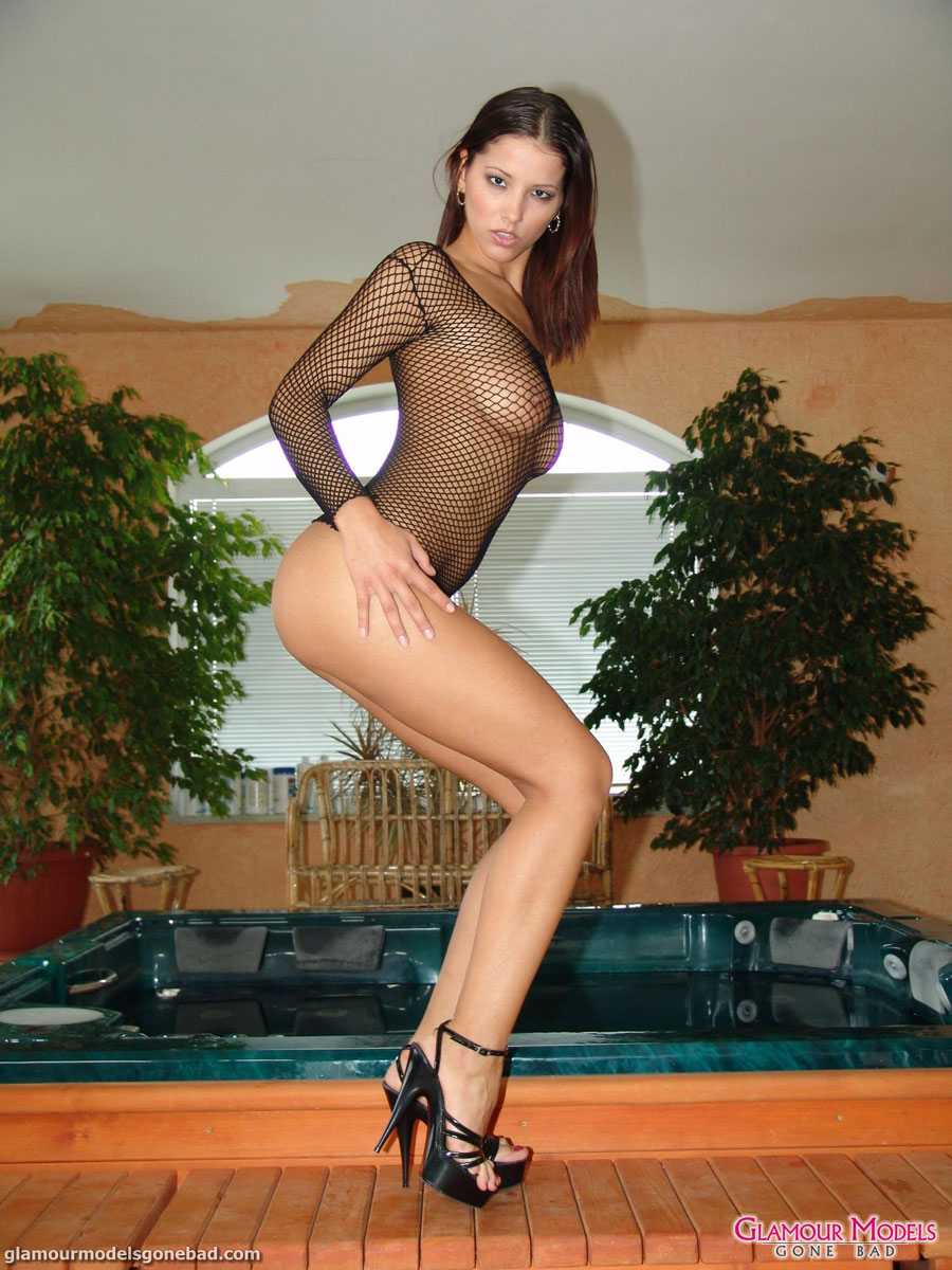 angel dark in black mesh and high heels