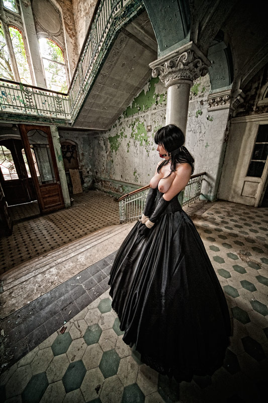 elegantly bound and topless in an abandoned mansion