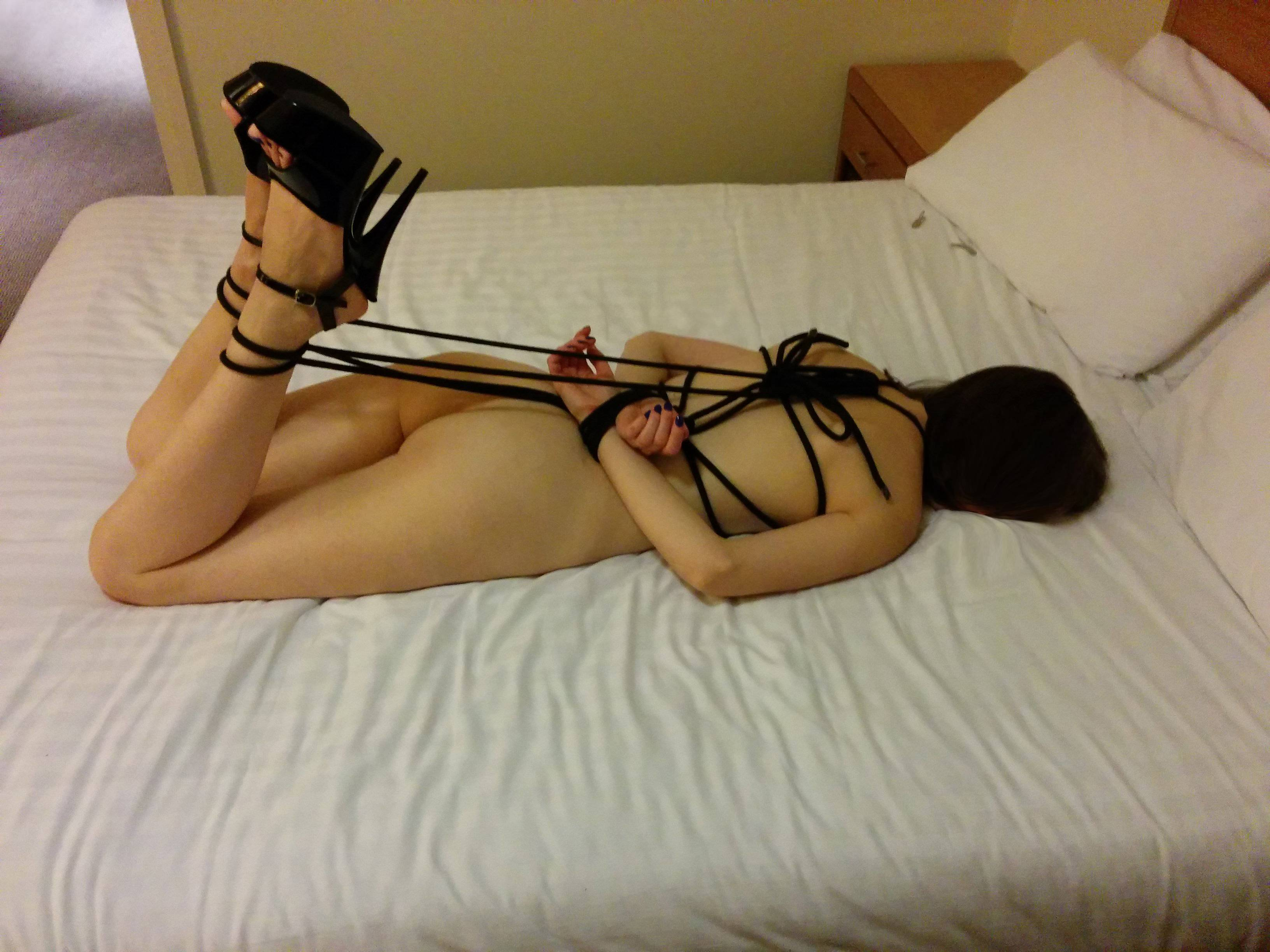 Brunette girl tied up to bed