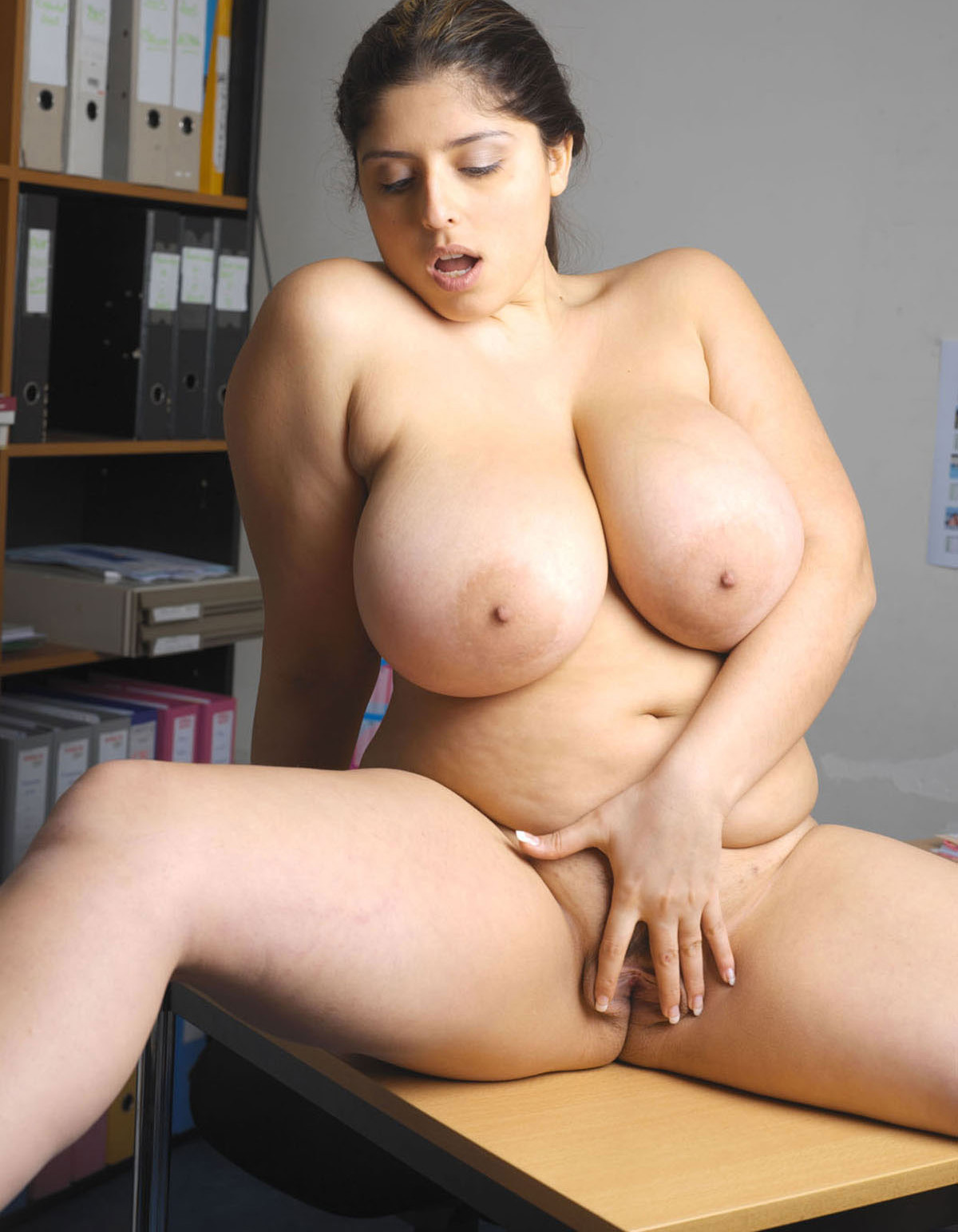 Gorgeous chubby redhead shows off big tits and fat ass 3