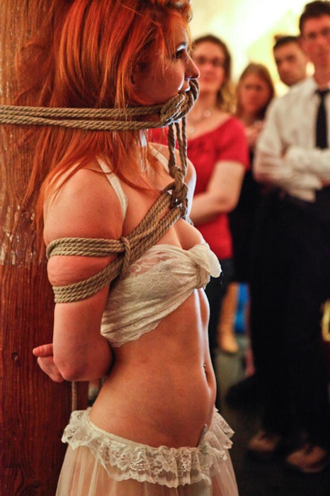 Redhead tied to the bed